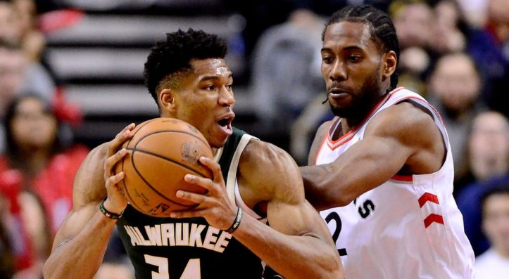 NBA-Bucks-Antetokounmpo-posts-up-against-Raptors-Leonard-1040x572.jpg
